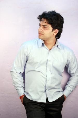 yong indian male model wearing cyan shirt photo