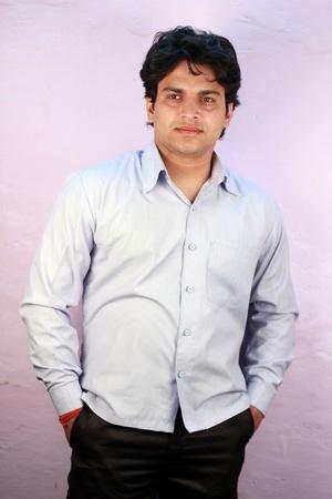 agrassive: yong indian male model wearing cyan shirt