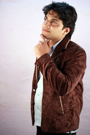 agrassive: yong indian male model wearing casual suit