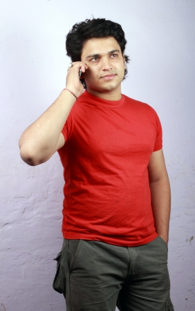 agrassive: yong indian male model wearing t-shirt and jeans