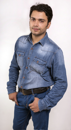 side pose: indian male model in blue jeans front side pose Stock Photo