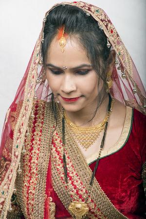 indian model in bride dress looking down