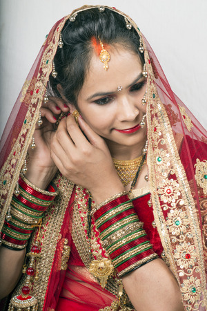 indian model in bride makeup looking down