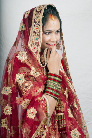 indian beautiful model in bride dress side pose