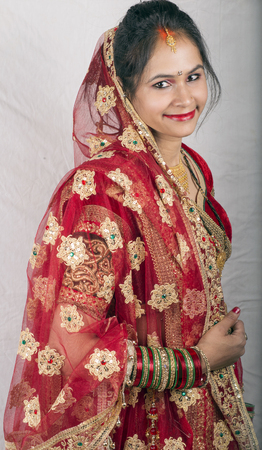 indian beautiful model in traditional bride dress side pose