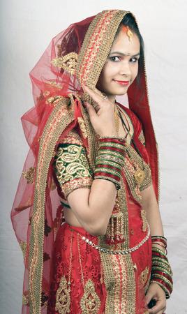 indian bride looking side wearing red dress