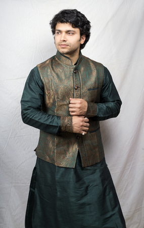 young indian male model in artistic green kurta side pose Stock Photo