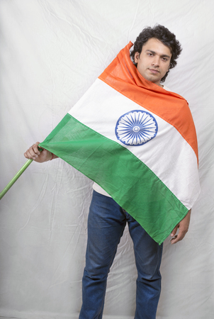 indian male model posing indian flag with blue jeans Stock Photo