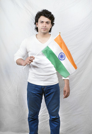young indian male holding indian flag Stock Photo