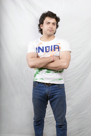 young asian model wearing tri color tshirt and blue jeans Stock Photo