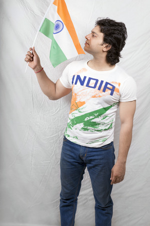 young indian model holding indian flag in blue jeans photo