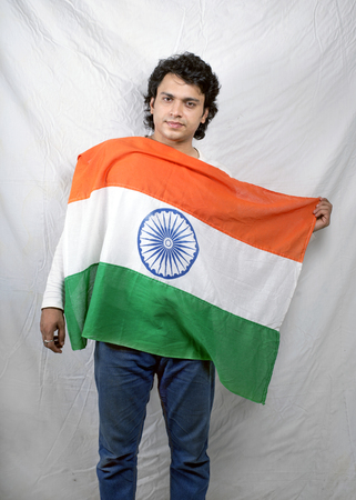indian model holding indian flag in chest Stock Photo