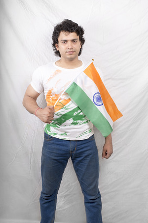 indian fitness male model posing with indian flag white tshirt photo