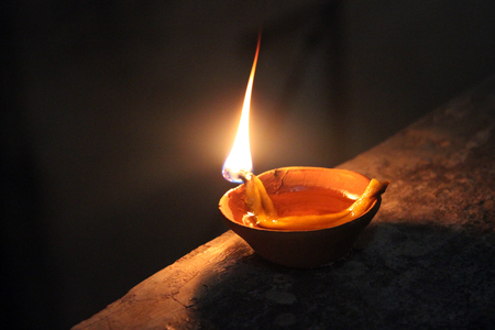 indian burning soil lamp in diwali night