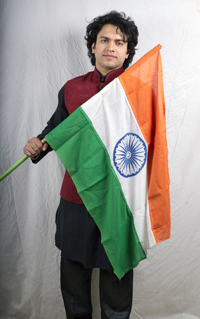 young  male model in black kurta with indian flag front pose