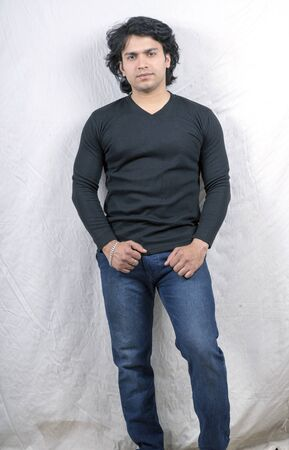 young indian model in black tshirt front pose