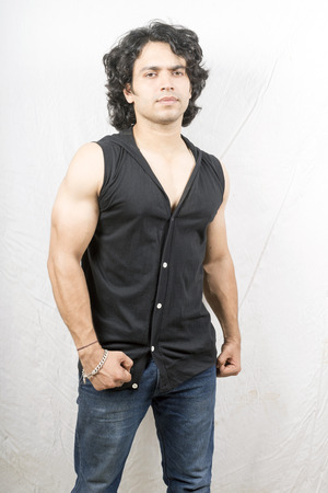 young male fitness model wearing half t-shirt front pose