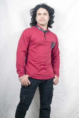 Indian male model posing with red kurta front pose