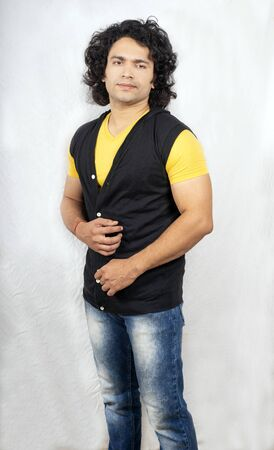 Indian male model wearing half yellow tshirt front pose