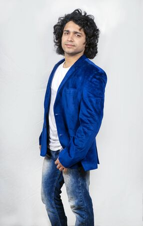 young indian male model wearing blue blazer side pose