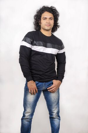 young indian male model wearing black tshirt front pose Zdjęcie Seryjne