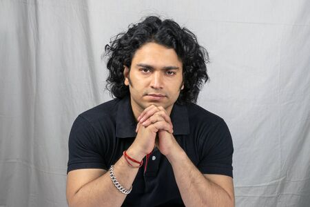 young indian model wearing black tshirt serious pose