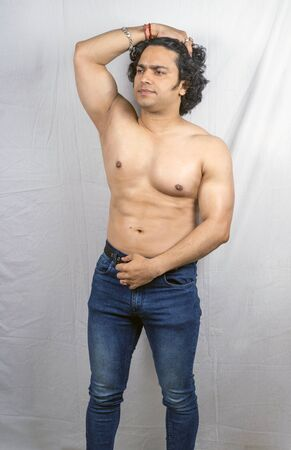 young indian bodybuilder posing topless front pose