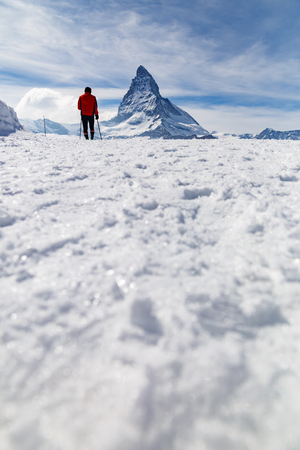 ski walking: A man walking on ski in the background of Matterhorn, Zermatt, Switzerland. Low-level view.