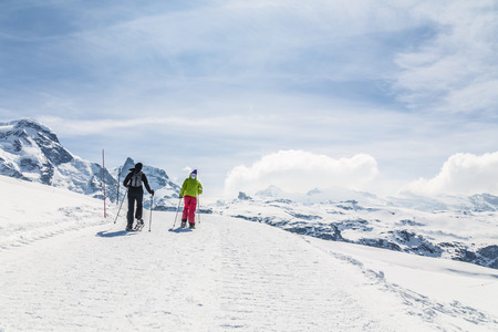 ski walking: Women walking on ski in the snow mountain.