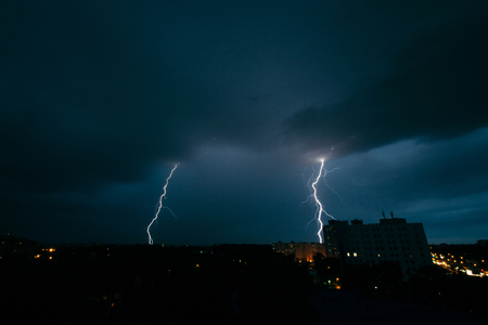 Lightning storm in Minsk, thunderstorm in dark skies Stock Photo