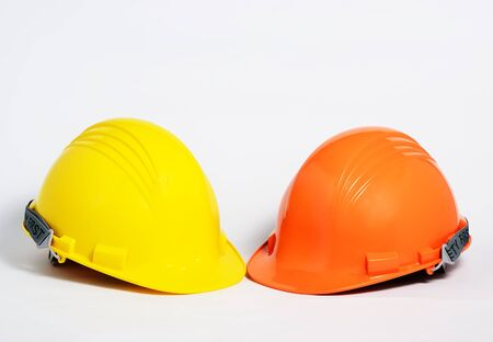 orange and orange helmet for builder worke Stock Photo - 17363714