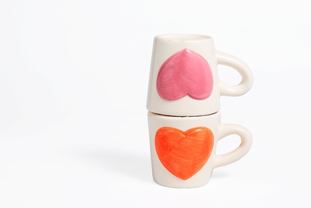 Two cup of love concept on Isolated white Stock Photo