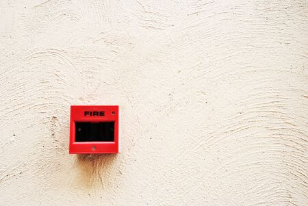Fire alarm switch on wall photo