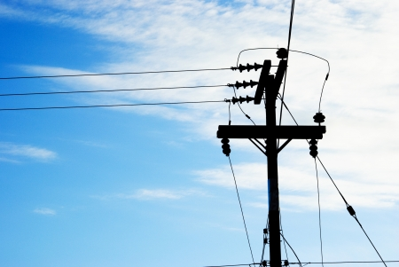 The electricity post on the blue sky background