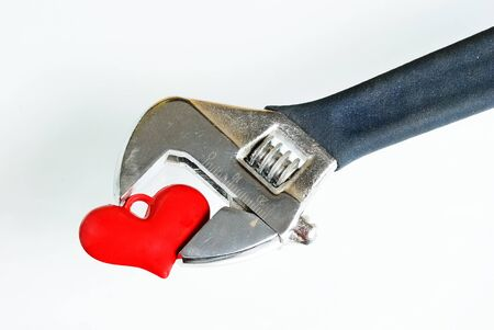 Adjustable Wrench with heart on isolated white background Stock Photo - 17847299