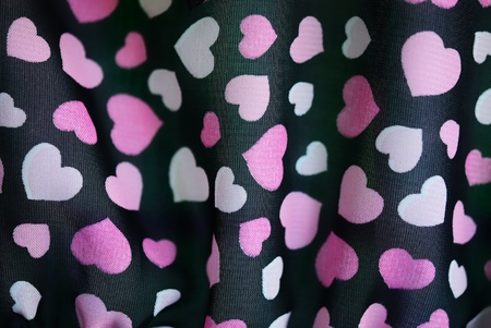 The colorful heart texture on a black fabric  Stock Photo