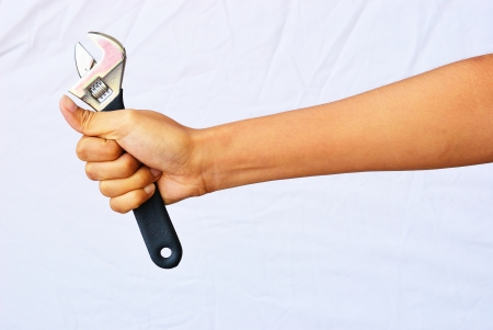 Asian woman hand hold the adjustable wrench Stock Photo - 18464895