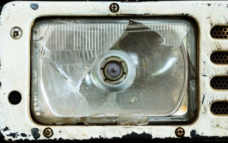 The broken tractor headlamp after accident in farm