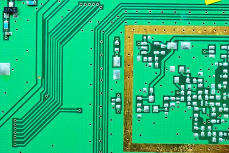 Close up on a processor line of the old electronic circuit boards  background photo