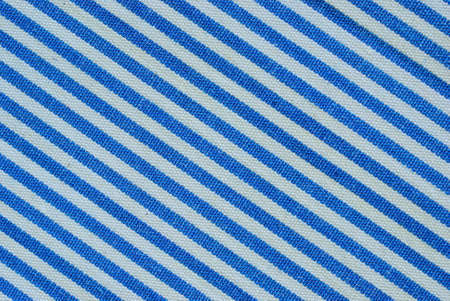 Close up on blue and white line fabric with 30 degree angle background photo