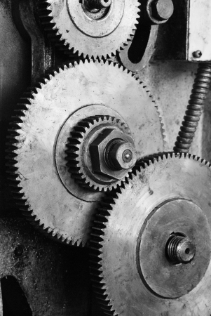 Dirty gear of the old lathe machine on black and white photo