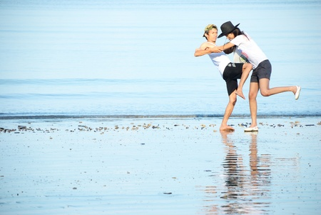 sensei: A man and woman fighting on the beach