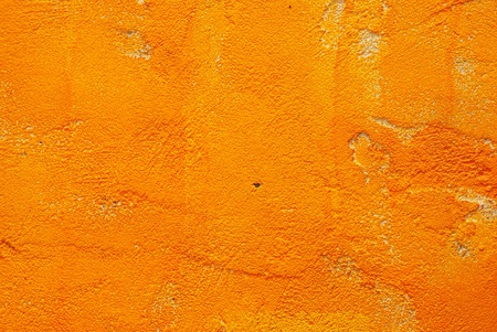 Abstract yellow color cement wall texture background photo