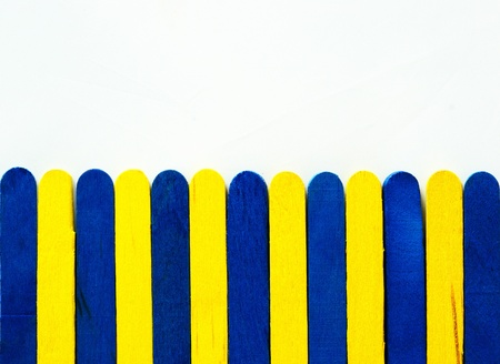 paling: Blue and yellow paling on isolated white