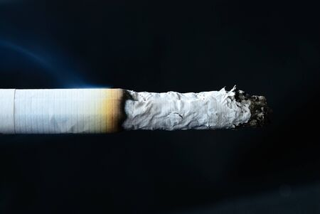Close up on the cigarette after burn with  isolated black Stock Photo