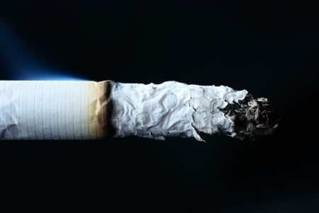 Close up on the cigarette with  isolated black Stock Photo