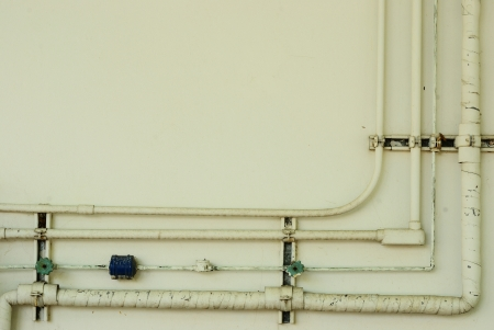 Old Air conditioner and electricity pipe line on wall photo