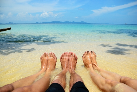 little girl barefoot: One man and two girl feelfree on the beach