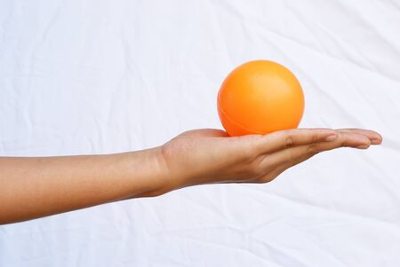 Put the orange ball on to your hand photo