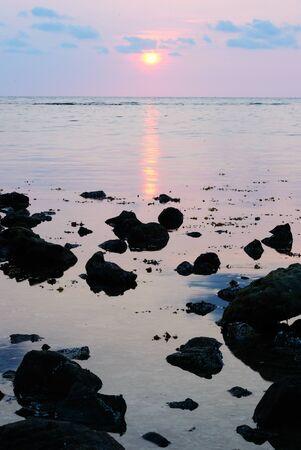 Sunset with rock foreground at Bailan Bay Koh Chang Thailand